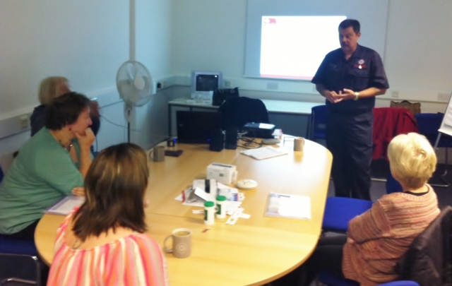 Andrew explaining fire safety tips to our CAREGivers